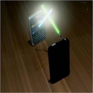 Photo: Smart Phones in Light Saber Battle